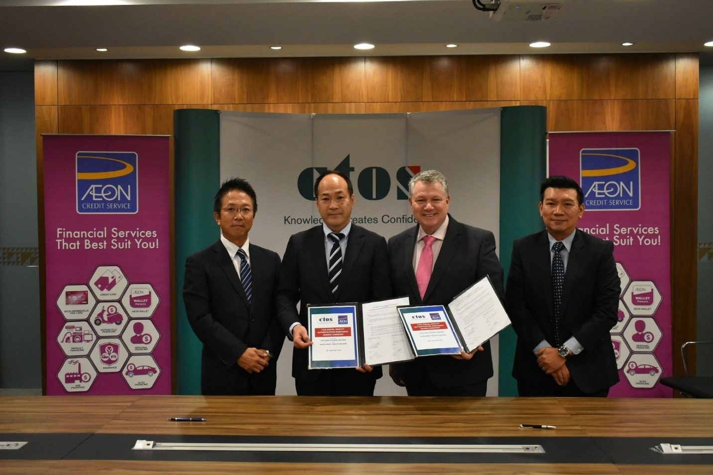 (From left) Aeon Credit chief marketing officer Shiro Ishida, managing director Yuro Kisaka, group CEO of CTOS Dennis Martin and CEO of CTOS Data Systems Sdn Bhd Group Eric Chin signed and witnessed the agreement to implement the CTOS eKYC solution.